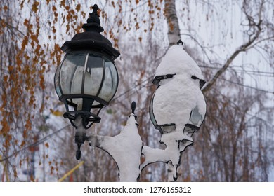 Street light covered by snow.