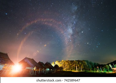 Street light flare with Milky way at Kudat Sabah Malaysia. Image contain soft focus and blur due to wide aperture and long exposure. image also contain grains and noise due to high ISO.