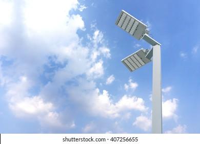 Street light pole with blue sky background.