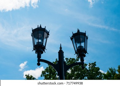 Street light set against a blue sky in London, Ontario