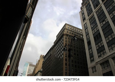 Street light and skyscrappers of New York in the cloudy september day