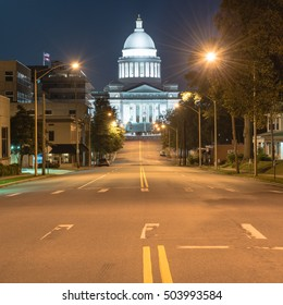 Street light and tree line leading to State Capitol of Arkansas, a scale replica of the US capitol located in Little Rock. The main house of Arkansas government, famous landmark and tourist attraction