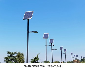 Street lighting poles with solar panels