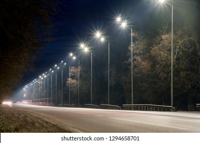 street lighting, supports for ceilings with led lamps. concept of modernization and maintenance of lamps, place for text, night. winter season. energy-saving lamps, safety of movement