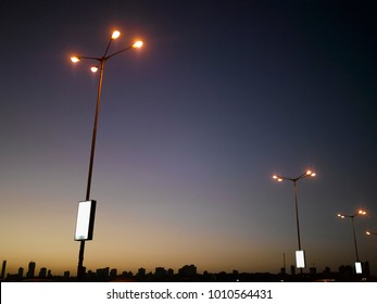 STREET LIGHTS WITH BACKLIT ADVERTISEMENTS ON MARINE DRIVE , MUMBAI, INDIA, ASIA