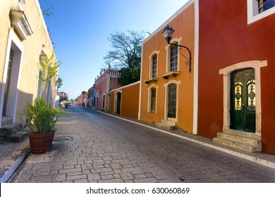 Street lined with colorful colonial buildings in Vallodlid, Mexico