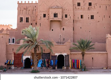 Street market in Ouarzazate village in front of traditional kasbah in Morocco