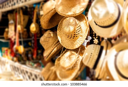 Street market selling hats and souvenirs in the touristic town of Varadero in Cuba photographed with a shallow depth of field