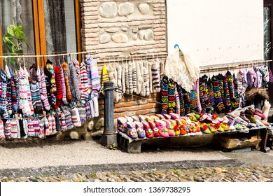 Street market in Signagi town, socks, woolen slippers and bright souvenirs selling on the street. Kakheti region, Georgia