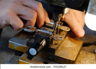 A street master makes a copy of the keys on a small machine, made in China