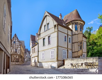 Street with medieval houses in historic quarter of Chartres, France