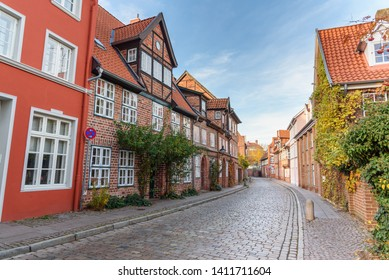 Street with Medieval old brick buildings in Luneburg. Germany