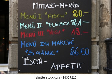 A street menu outside a restaurant advertising the daily specials.