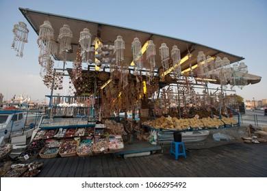 Street mini-market in Corfu, Greece, summertime, souvenirs, sponges, shells.