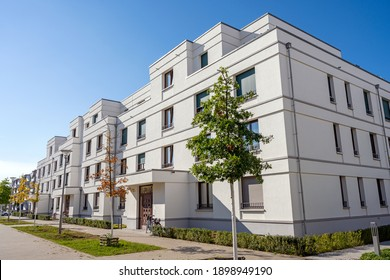 Street with modern white townhouses in Berlin, Germany
