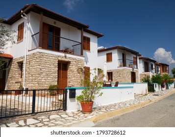 The street of modern white villas and houses of Pano Lefkara village. Larnaca District. Cyprus