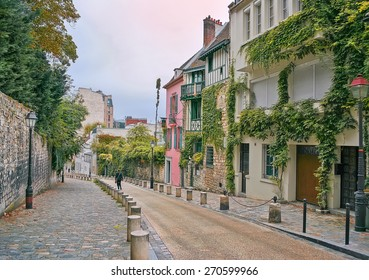 street in Montmartre, Paris, France, in the evening