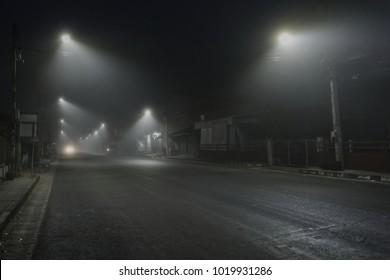 street Morning mist Street lights foggy misty night lamp Alley at the foggy street at night blur.