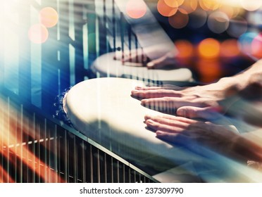 Street music background. Hands on percussion, abstract urban details and lights
