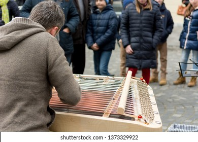 Street musician performing outdoor infront of live audience.