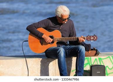 street musician playing classical guitar. Lisbon , PortugalMarch 2019