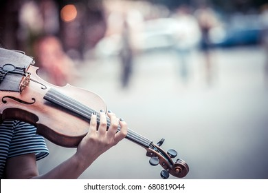 Street musician playing violin