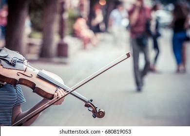 Street musician playing violin