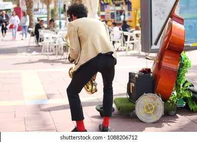 Street musicians play jazz on the town square