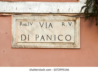 "street name carved in stone in Rome Translation: ""Di Panico Street"""