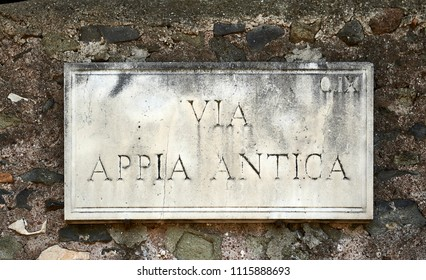 "street name carved in stone in Rome Translation: ""Apia Antica Street"""