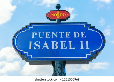 street name sign of the historic bridge Puente de Isabel II, Seville, Spain, with the sign NoDo, that is a public sign for Seville