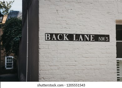 Street name sign on a side of the building on Back Lane, Hampstead, London, UK.