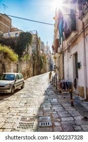 street near sea port in the old center of Brindisi, region Puglia, Italy