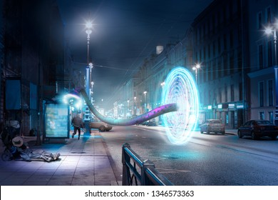 Street night city. Homeless, runaway man and a fantastic portal with a manipulator