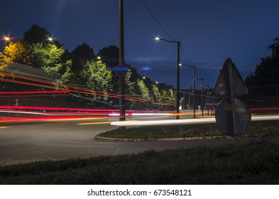 A street in the night with lighttrails