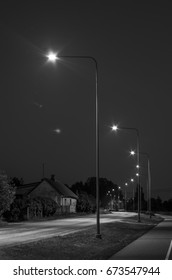 A street in the night with streetlights