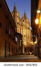Street at Night with a view at the Clerecia Church, Salamanca, Spain.
