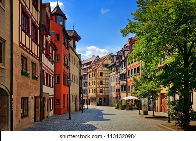 Street in Nuremberg. Half-timber work on the facade of wooden buildings in the German city of Nuremberg, Bavaria. Traditional architecture 'Fachwerkhaus' Timber framing Horizontal view, stone paving.