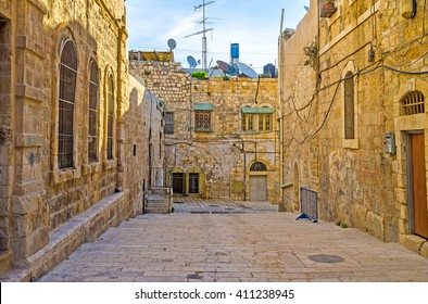 The street of the old city with the medieval stone residential houses, Jerusalem, Israel.