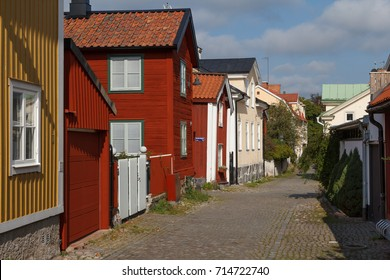 Street in the old part of Vasteras town with traditional wooden houses, Sweden