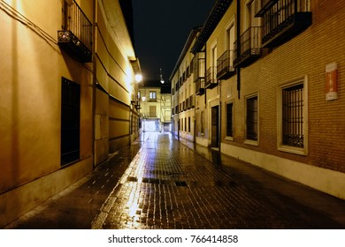 "Street in the old town of Alcala de Henares, Spain called ""de la Imagen"" on a rainy and very lonely night"