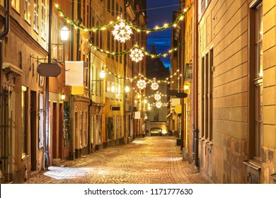 Street in Old Town (Gamla Stan) decorated for Christmas time at night, Stockholm, Sweden