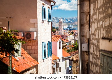 Street of Old Town Split in Dalmatia region, Croatia. Medieval Houses with Red Roofs. Popular Tourist Destination at Adriatic Sea. Mediterranean Europe Travel Concept.