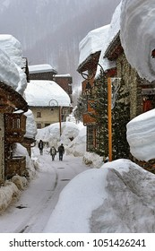 A street in the old village of Val d'Isère during snowfall