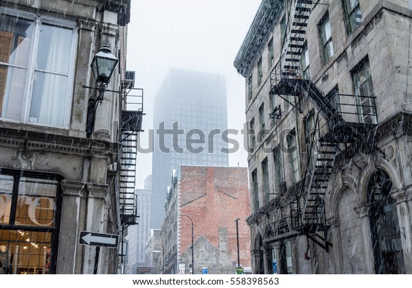 Street in Old-Montreal in winter under the snow. Montreal is the capital city of Quebec, in Canada
