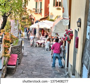Street on the lakeside of Varenna, a well-known Italian village in the province of Lecco with many German tourists