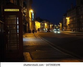 A street in Oxford during the night. With the classical English telephone cell.