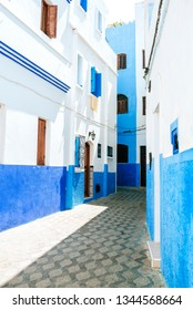 Street painted white and blue in Asilah, Morocco
