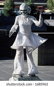 Street performer busking on city street