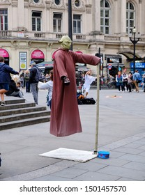 Street performer dressed up as Yoda, levitating in Piccadilly circus in centre of London, UK. September 6, 2019